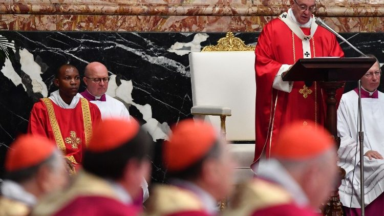 Cardinals listen to Pope Francis at a Mass in St. Peter's Basilica