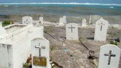 A cemetery in low-lying Marshall Islands being flooded by high tides