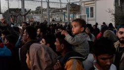 Refugees and migrants protest at the Moria detention centre on the Greek island of Lesbos