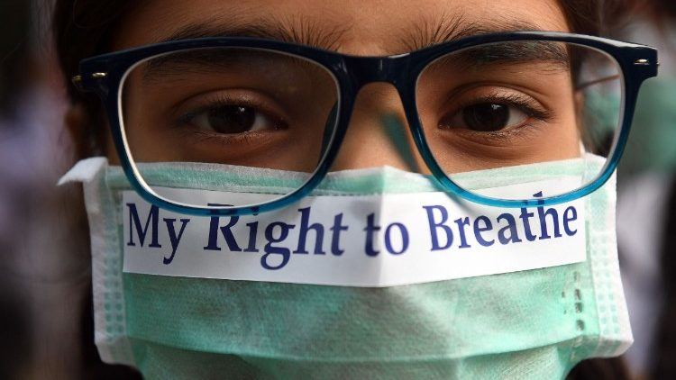 An Indian youth in a march to raise awareness about air pollution.