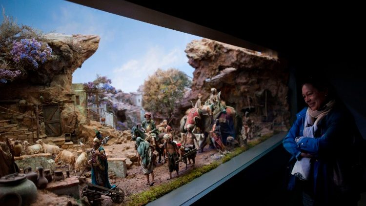 Woman looking at a Nativity Scene in the world's largest musuem of nativity scenes in Spain.