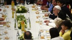 Pope Francis shares a meal with homeless people on the World Day of the Poor