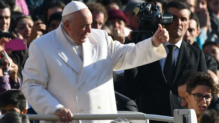Pope Francis greets the crowds at his general audience.