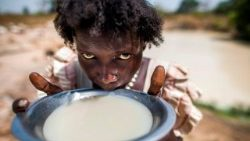 Alissa Lual, a displaced mother of three, collects water at a road construction site in South Sudan