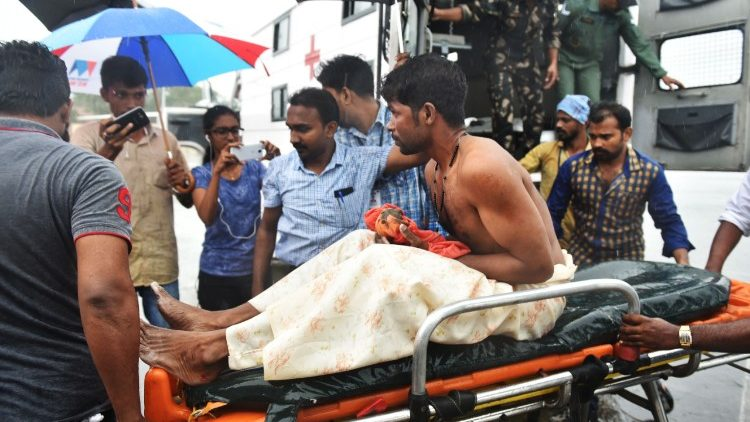 A stranded fisherman rescued by Indian naval and air force from Okhi arrives at Thiruvananthapuram