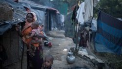 A Rohingya woman and her child in a refugee camp in Bangladesh