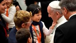 Pope Francis greeting child during his audience with donors for the Christmas Tree and the Nativity Scene in St. Peter's Square
