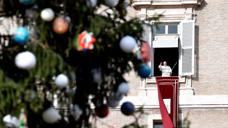 Pope Francis giving his Angelus address on the Feast of the Immaculate Conception with the Christmas Tree in the foreground.