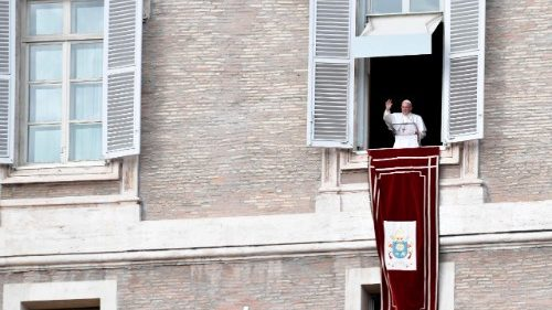 Pope Francis greets the crowds in St. Peter's Square for the Sunday Angelus