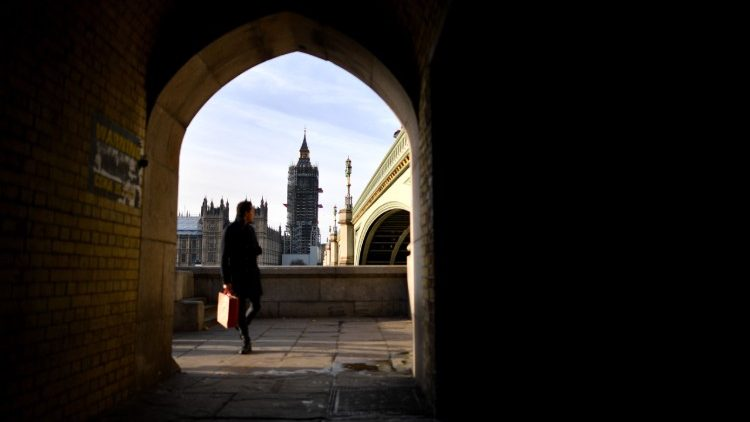 A view of the Houses of Parliament under Westminster Bridge in London