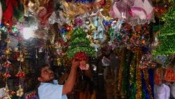 Sri Lankan vendor arranges Christmas decorations for sale