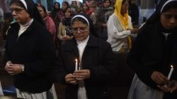 Pakistani Christians take part in a service for the victims of a suicide attack at the Sacred Heart Cathedral in Lahore in 2017