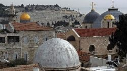 a view of Jerusalem's Old City with the Dome of the Rock on the left and the two domes of the Holy Sepulchre Church on the right