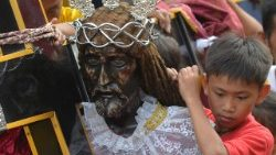A closeup of the statue f the Black Nazarene.