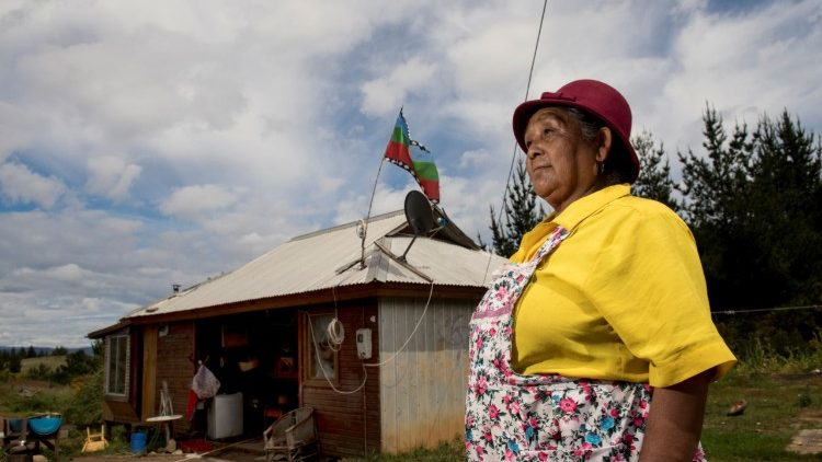 Chilean Mapuche woman posing outside her home in Temulemu, Temuco