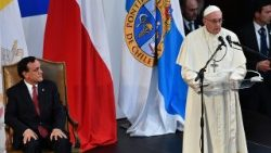 Pope Francis speaks next to Pontifical Catholic University of Chile rector Igancio Sanchez Diaz