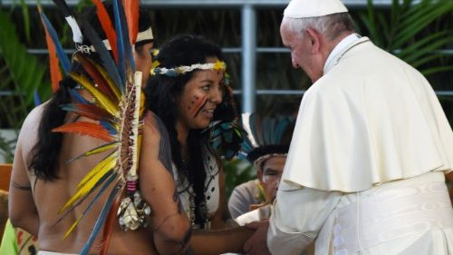 Pope Francis greets representatives of indigenous communities of the Amazon basin during a visit to the Peruvian city of Puerto Maldonado in January 2018