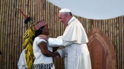 Pope Francis greets an indigenous woman during a meeting with indigenous communities of the Amazon during his visit to Perù