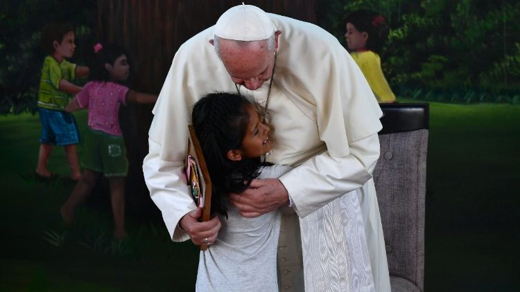 "Pope Francis is hugged by a girl during his visit to ""The Little Prince"" children's home in Puerto Maldonado"