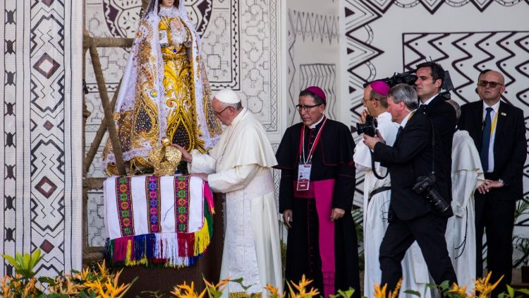 Pope Francis venerates a statue of the Blessed Virgin Mary at the conclusion of his meeting with local citizens