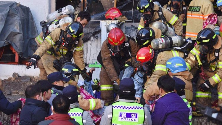 South Korean rescue workers on the scene of a fire in a hospital in Miryang