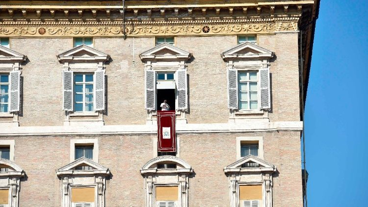 Pope Francis addresses the crowds in St. Peter's Square during Sunday Angelus