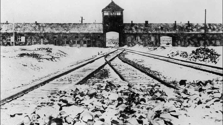 This file photo from January 1945 shows the Auschwitz concentration camp's gate and railways after liberation