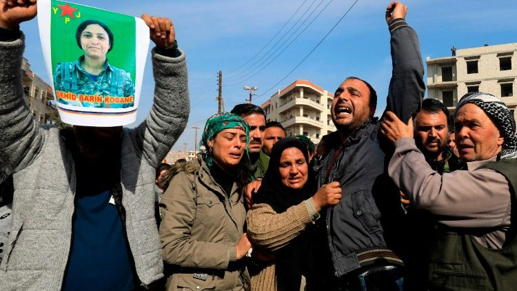The family of the late 23-year-old YPJ fighter Barin Kobani during a mourning ceremony after Turkish-backed Syrian rebels filmed her mutilated body