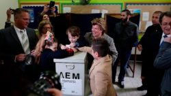 The first lady of Cyprus, Andri Anastasiades, casts her ballot at a polling station in Limassol