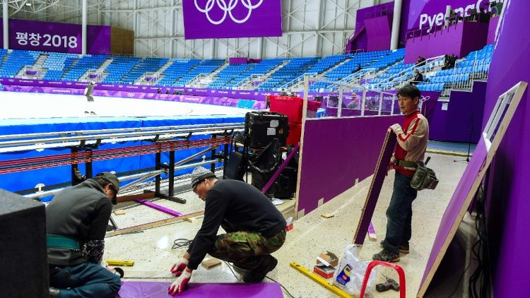 South Korean workers put finishing touches on the Ice Arena ahead of the Pyeongchang Winter Olympics