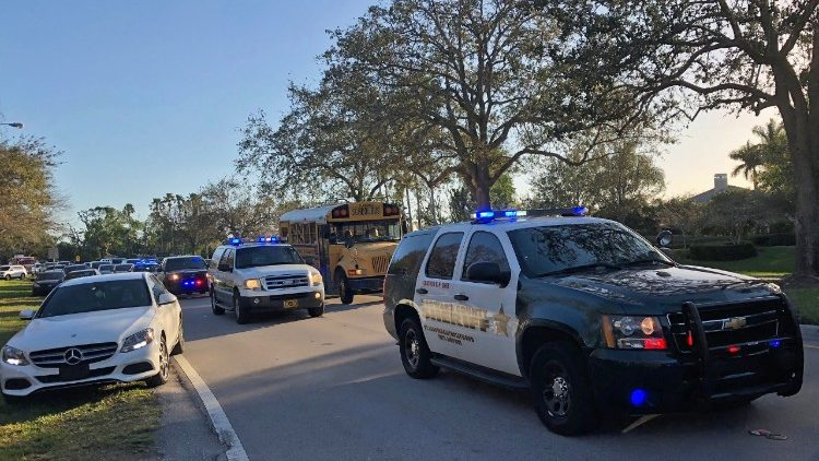 Sheriff vehicles are seen at the Marjory Stoneman Douglas High School in Parkland, Miami