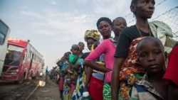 Congolese refugees wait to board buses as they flee across the border into Uganda