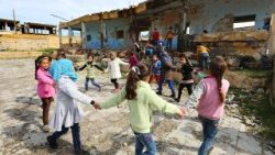 Syrian children outside their destroyed school in Idlib