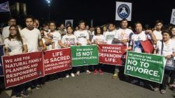 "Philippine Catholics carry placards in a ""March for Life"" in the capital Manila, Feb. 24, 2018."