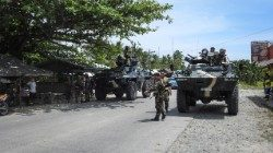 Fillipino soldiers patrol a road in the southern island of Mindanao which is under martial law