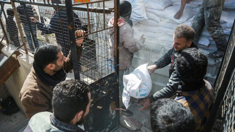 Humanitarian aid being distributed in the Syrian town of Douma in the rebel-held enclave of eastern Ghouta