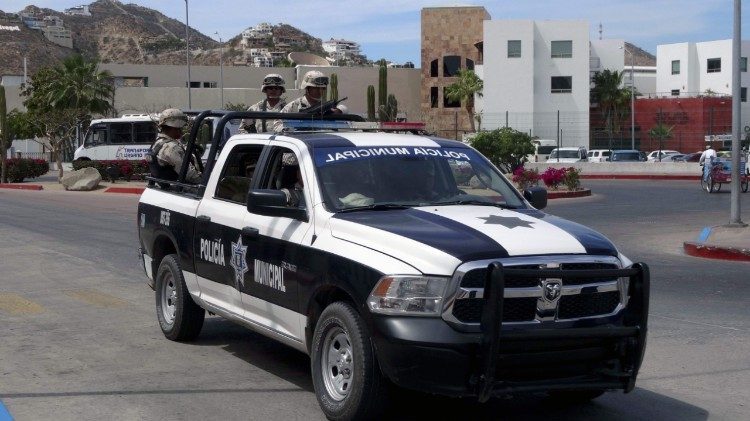 Mexican municipal police officers patrol streets in Los Cabos, Mexico