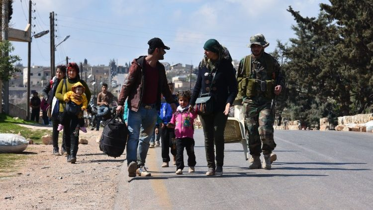 Families flee from the fighting in Northern Syria