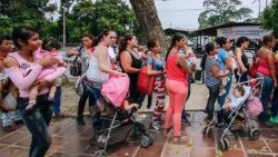 Venezuelans, who have crossed the border into Colombia, queue for vaccinations