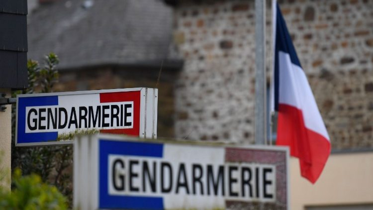 A French flag is lowered half mast as a tribute to French Lieutenant Colonel Arnaud Beltramme