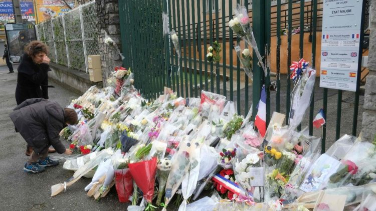 Flowers outside the gendarmerie of Carcassonne pay tribute to slain Lieutenant-colonel Arnaud Beltrame