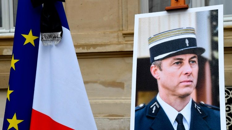 A picture of French gendarme Arnaud Beltrame outside the Interior Ministry during a day of national mourning on Wednesday