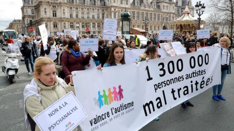 "People participate in the ""March for Hope"" rally in Paris marking World Autism Awareness Day"