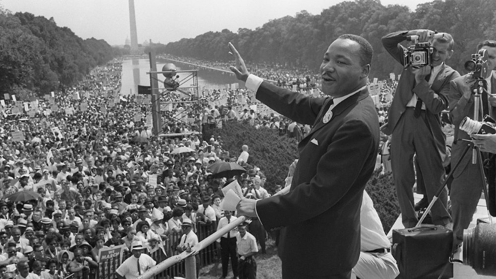 "Martin Luther King waves to supporters during the ""March on Washington"" in 1963"