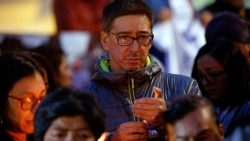 Colleagues of the Ecuadorean journalists and driver kidnapped and killed by renegade FARC rebels hold a vigil