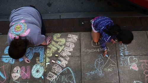Families write messages of racial and community unity
