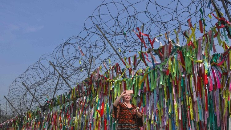 A military fence covered in peace ribbons at a park near the Demilitarised Zone dividing North and South Korea