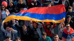 Supporters of Armenia's opposition leader wave the national flag during a rally in Yerevan