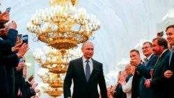 Russian President-elect Vladimir Putin walks to take the oath of office at the Kremlin