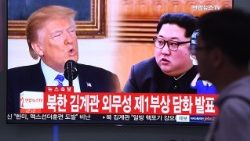 A television news screen in Seoul shows footage of  the North Korean leader and the US President ahead of a planned summit